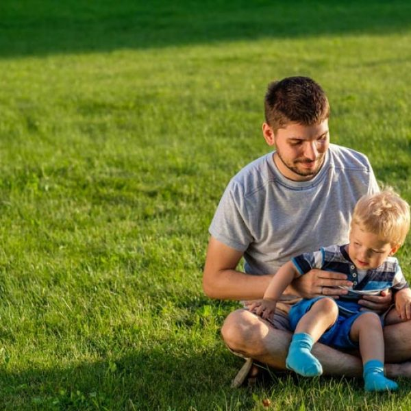 happy-father-and-son-having-fun-outdoor-on-meadow