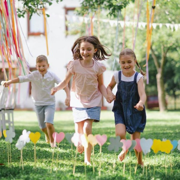 small-children-outdoors-in-garden-in-summer-running-when-playing